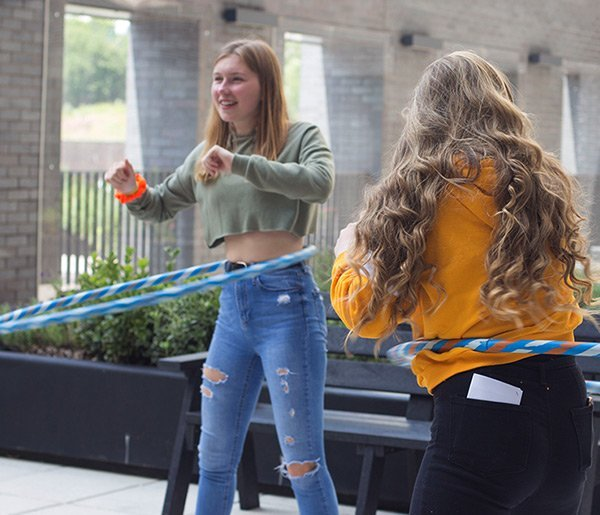 young person playing with hoop