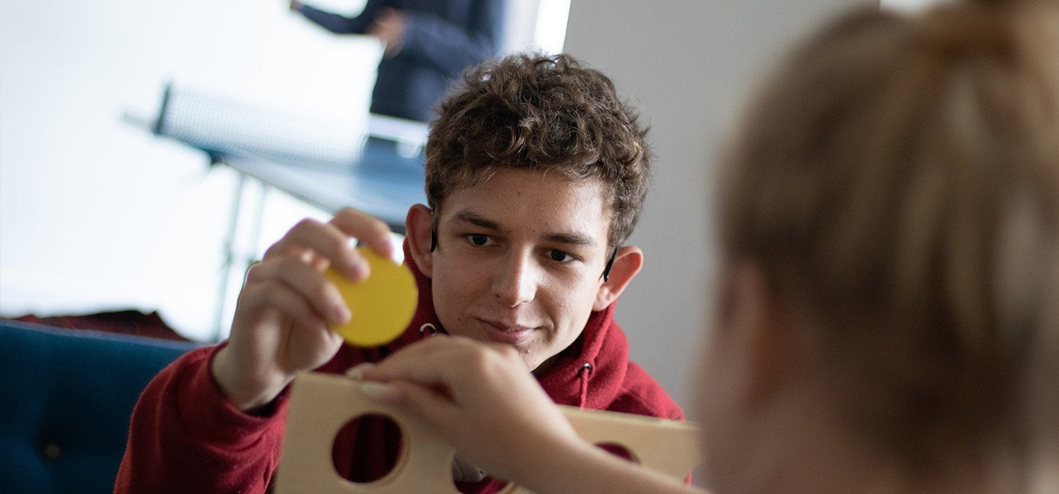 young person playing connect four