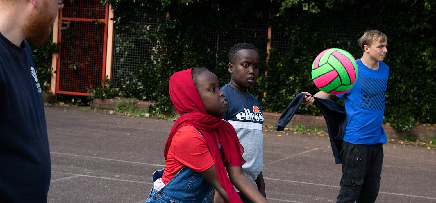 Young people playing volleyball in Birmingham