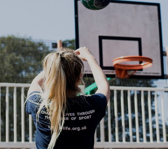 Young person playing basketball in sport 4 life t-shirt