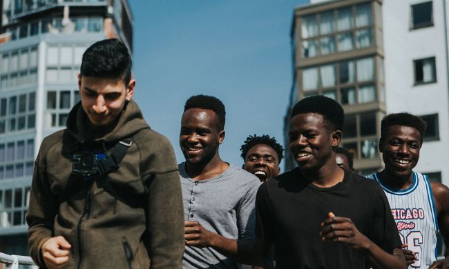 Young people walking through Birmingham city centre
