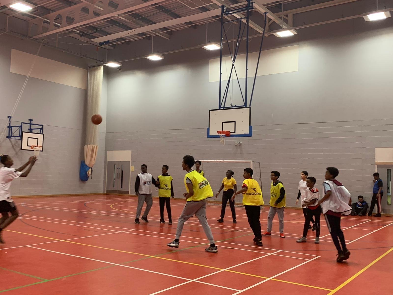 young people on basket ball court