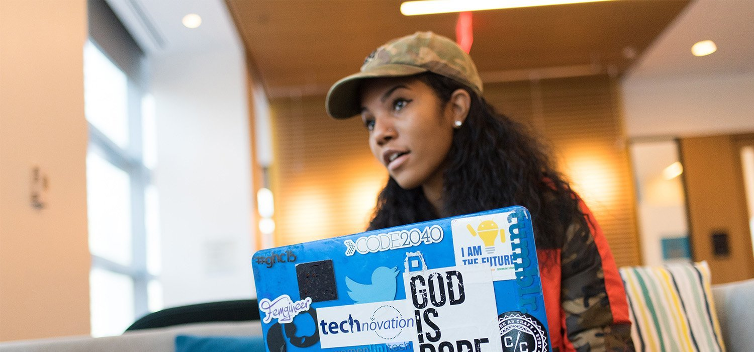 young person on laptop